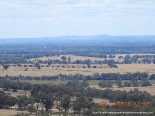 The many peaks of the Puckapunyal Ranges, in the distance.