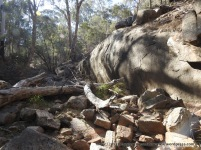 Creek bed incised around resistant mass of granite.
